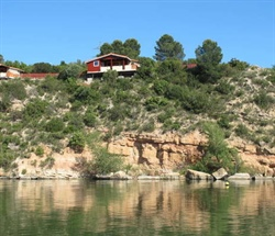 Riba Roja Reservoir Chalet No. 5 in front with boat & depth sounder